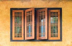 Vintage wood window on yellow crack wall Stock Image