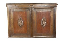 Vintage wooden art Nouveau cabinet on white background. Historical cabinet with glass showcase. Detail Vintage wooden art Nouveau cabinet on white background royalty free stock photo