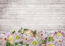 Vintage wooden background with a border of delicate flowers. With a place for a photo or text Stock Image