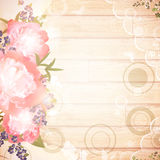 Vintage wooden background with floral decoration. And lace frame Stock Photography