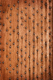 Vintage wooden background with metal rivets Stock Photography