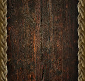 Vintage wooden background. With the old rope Stock Photos