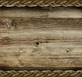 Vintage wooden background. With the old rope Stock Photo