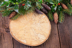 Vintage Wooden Background with Pine Branch and Tree Ring Royalty Free Stock Images
