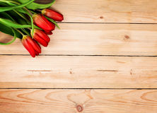 Vintage Wooden Background with red Tulip Flowers Stock Image
