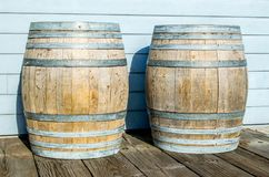 2 vintage wooden barrels outside a winery in Santa Barbara, California. 2 vintage wooden barrels outdoors against the wall of a winery in Santa Barbara royalty free stock images