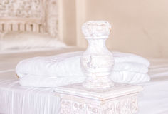Vintage wooden bed in the bedroom Royalty Free Stock Photos