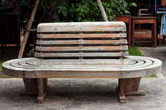 Vintage wooden bench on railway station Stock Photos