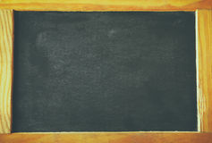 Vintage wooden blackboard on wooden table with space for text Royalty Free Stock Photos