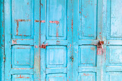 Vintage wooden blue cyan doors. Old house with vintage wooden blue cyan doors. Vintage blue cyan doors concept use for background Stock Photo
