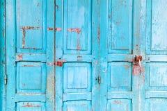 Vintage wooden blue cyan doors stock photo