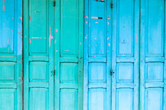 Vintage wooden blue cyan doors. Old house with vintage wooden blue cyan doors. Vintage blue cyan doors concept use for background stock photography
