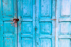 Vintage wooden blue cyan doors. Old house with vintage wooden blue cyan doors. Vintage blue cyan doors concept use for background Royalty Free Stock Photo
