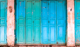 Vintage wooden blue cyan doors stock photos