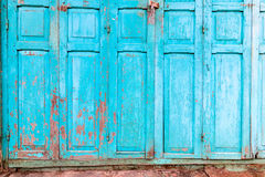 Vintage wooden blue cyan doors. Old house with vintage wooden blue cyan doors and gray cement wall. Vintage blue cyan doors concept use for background Royalty Free Stock Images