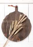 Vintage wooden board and spikelets of wheat (rye) Royalty Free Stock Photography