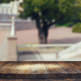 Vintage wooden board table in front of rustic counrty garden landscape Royalty Free Stock Photos