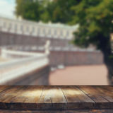Vintage wooden board table in front of rustic counrty garden landscape Royalty Free Stock Photo