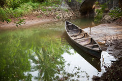 Vintage wooden boat. In water with its reflection Stock Photography
