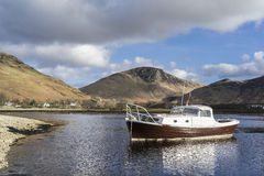 Vintage wooden boat on Lochranza on the Isle of Arran. Royalty Free Stock Photo