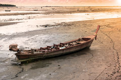 Vintage wooden boat. Tied up on compact sand background Stock Photo