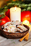 Vintage wooden bowl of gingerbread cookies on christmas eve tabl Stock Images