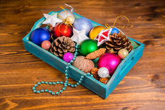 Vintage wooden box with Christmas decoration, tinsel,  pinecones Stock Image