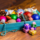 Vintage wooden box with Christmas decoration, tinsel,  pinecones Royalty Free Stock Photos