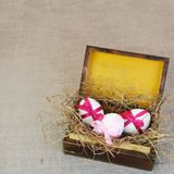 Vintage Wooden Box with Easter Tied Eggs Royalty Free Stock Photos