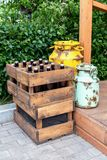 Vintage wooden boxes with craft beer bottles and metal cans. Standing outdoors Royalty Free Stock Image