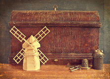 Vintage wooden boxes and model windmill. Stock Photo