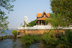 Vintage wooden Buddhist temple on the banks of the Chao Phraya river. Bangkok Royalty Free Stock Photos