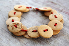 Vintage wooden buttons bracelet. On table Stock Photo