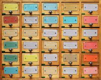 Free Vintage Wooden Cabinet With Multicolor Labels Stock Photo - 153489390