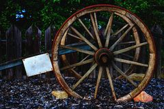 Vintage wooden carriage wheel. With empty label Royalty Free Stock Image