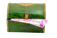 Vintage wooden casket from India with rupees notes Royalty Free Stock Images