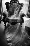 Vintage wooden chair covered with a veil Stock Photography