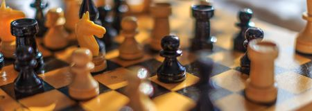 Vintage wooden chess on the chess board stock photography
