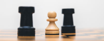 Vintage wooden chess on the chess board closeup. Vintage wooden chess on the chess board Royalty Free Stock Image