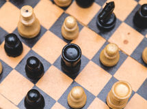 Vintage wooden chess on the chess board closeup. Vintage wooden chess on the chess board Royalty Free Stock Photos