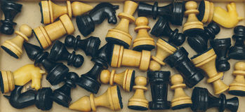 Vintage wooden chess on the chess board closeup. Vintage wooden chess on the chess board Stock Photography