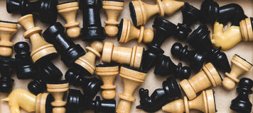 Vintage wooden chess on the chess board closeup. Vintage wooden chess on the chess board Royalty Free Stock Images
