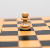 Vintage wooden chess on the chess board closeup. Vintage wooden chess on the chess board Stock Photos