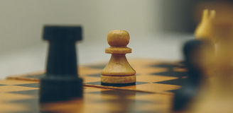 Vintage wooden chess on the chess board closeup. Vintage wooden chess on the chess board Stock Images