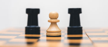Vintage wooden chess on the chess board closeup. Vintage wooden chess on the chess board Stock Photo