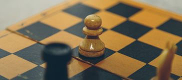 Vintage wooden chess on the chess board closeup. Vintage wooden chess on the chess board Royalty Free Stock Photography