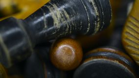 Rook and knight macro. Vintage wooden chess pieces in box, sliding camera movement stock video footage