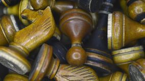 Vintage chess in box. Vintage wooden chess pieces laying in box, sliding camera movement stock video footage