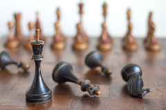 Vintage wooden chess pieces on an old chessboard. Stock Images