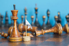 Vintage wooden chess pieces on an old chessboard. Stock Image